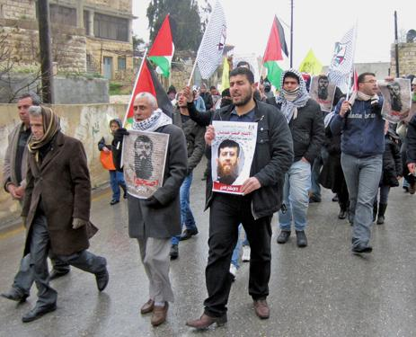 Protesters march through Nabi Saleh in solidarity with hunger striker Khader Adnan