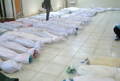 The bodies of civilians massacred in the city of Houla
