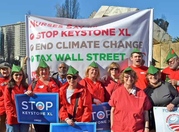 Members of National Nurses United protest the Keystone XL pipeline