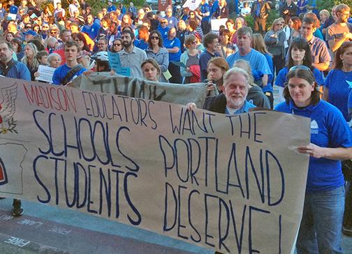 Madison High School teachers at the front of the crowd outside Portland Public Schools headquarters