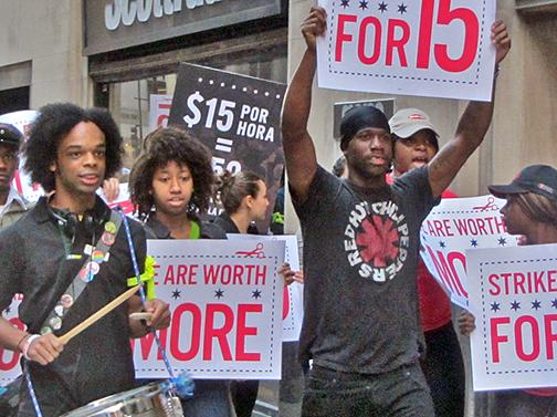 Low-wage workers on strike march for a $15 minimum wage