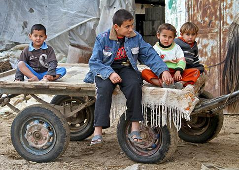 Refugee children in Gaza playing on a horse-drawn cart