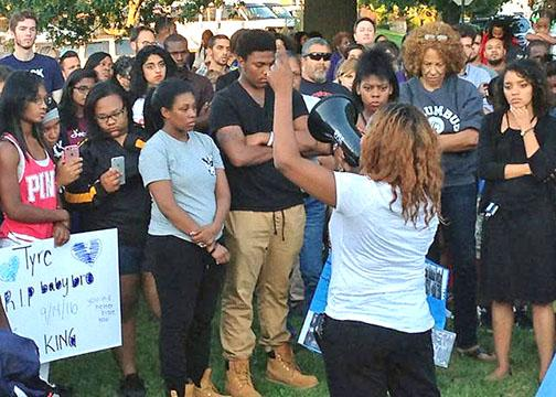 Mourners demand justice for Tyre King at a vigil in Columbus, Ohio