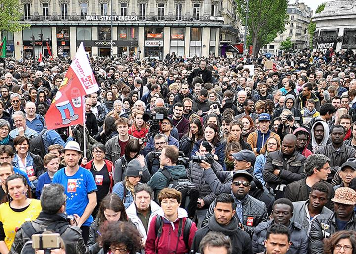 Thousands demonstrate in Paris against austerity the day after Emmanuel Macron's victory