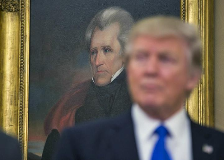 Trump speaks as Andrew Jackson looks on