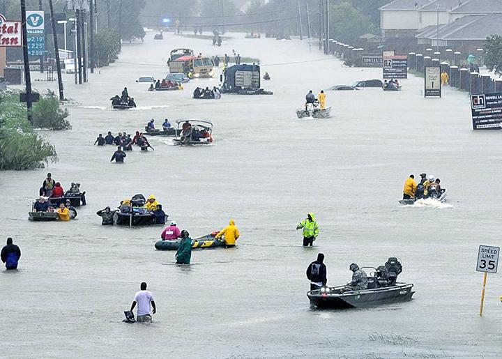 Thousands attempt to flee the devastating flooding in Houston, Texas