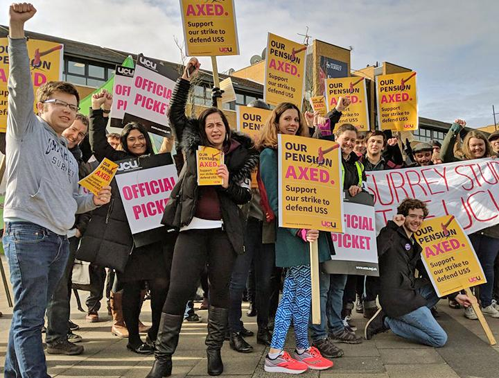 Striking university workers on the picket lines in Surrey, southwest of London