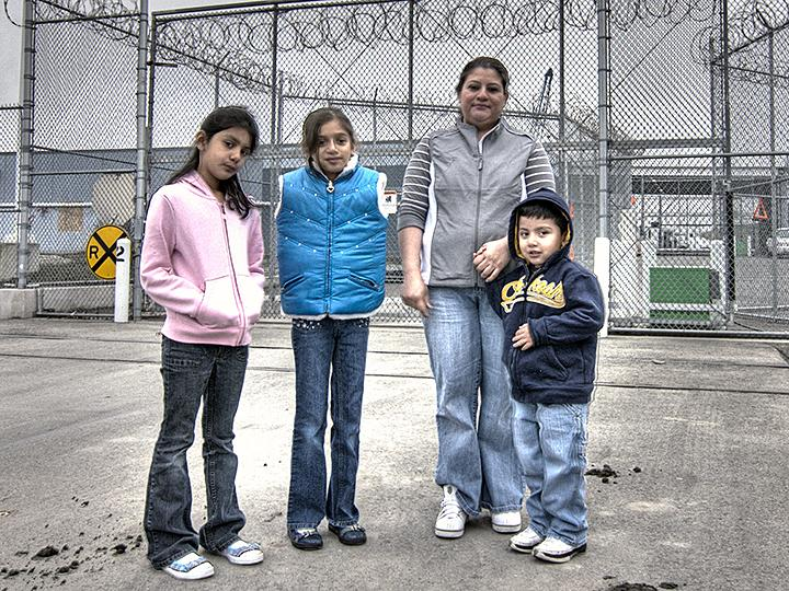 A family of immigrants stands outside the Northwest Detention Center in Tacoma, Washington