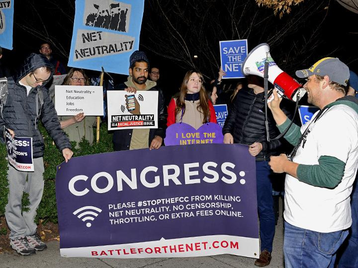 Defenders of net neutrality protest FCC Chair Ajit Pai and telecom lobbyists in Washington, D.C.