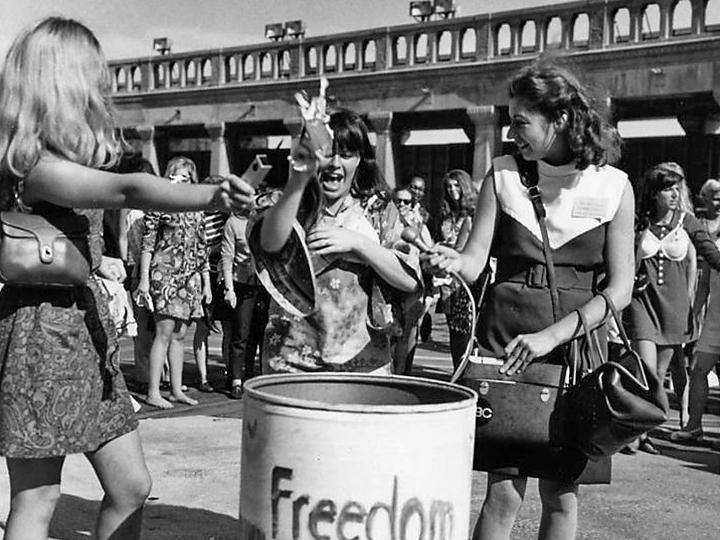 "Demonstrators toss symbols of sexism into the ""Freedom Trash Can"""