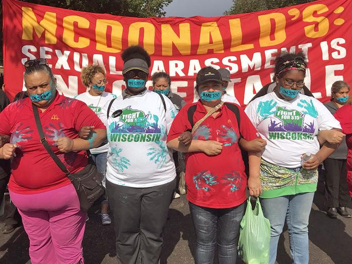 McDonald's workers hold a silent march against sexual abuse at the company's headquarters