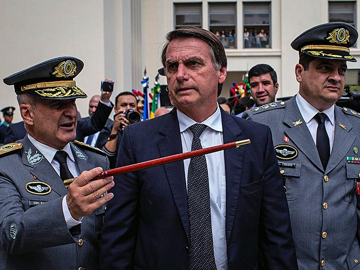 Far-right presidential candidate Jair Bolsonaro speaks with Brazilian generals