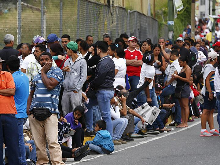 Waiting in line for basic supplies in Caracas