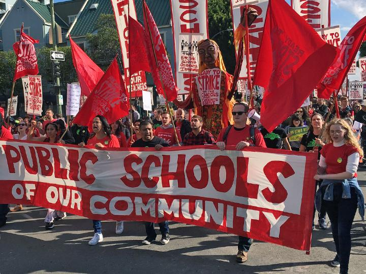 Oakland teachers march in defense of public schools