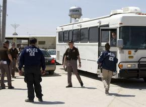 A Homeland Security bus loaded with detainees leaves the Agriprocessors Inc. plant where ICE agents arrested more than 300 people in May 2008