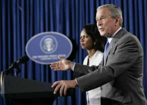 George Bush issues a statement on the Middle East while Secretary of State Condoleezza Rice looks on