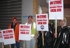 The strike by sprinkler workers has shut down building sites across western Washington