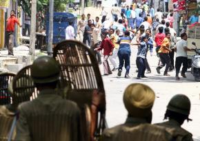 "Protesters demanding ""azadi"" confront riot police on the streets of Jammu in Kashmir"