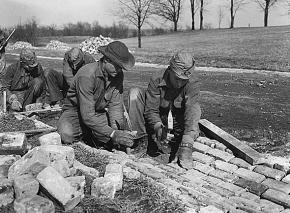 A Civilian Conservation Corps crew constructing a new road