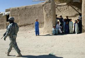 A U.S. soldier moves through Pana, Afghanistan, during a cordon and search
