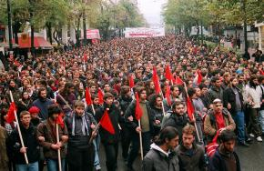A mass protest against the Karamanlis government winds its way through the streets of Athens