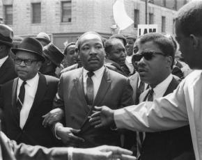 Martin Luther King marches for striking sanitation workers in Memphis on March 18, 1968