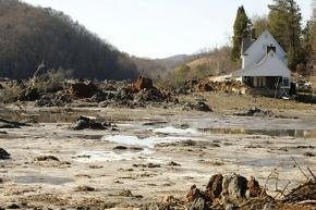 The spill from a coal-ash containment pond spread over 300 acres of land, and poured into streams and rivers