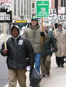 Supporters of Republic WIndows and Doors workers picket outside of Bank of America