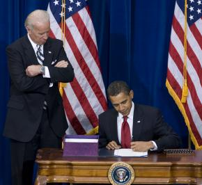 Barack Obama signs the economic stimulus bill