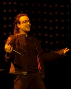 Bono performing with U2 in Boston