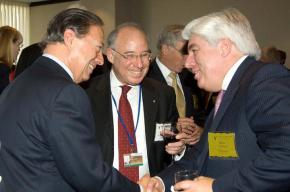 Former AIG CEO Martin J. Sullivan (left) hobnobs with the financial elite at an international banking seminar