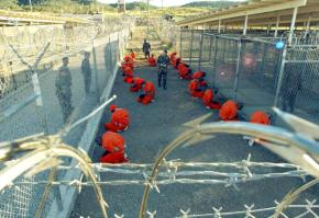 Detainees wait in a holding area at Guantánamo Bay's Camp X-Ray in 2002