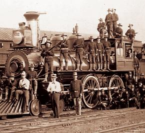 Government troops protect a train during the Pullman strike in 1894