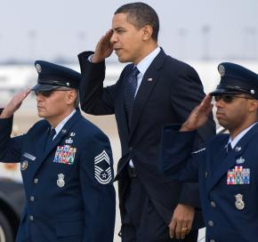 Barack Obama salutes as he exits Air Force One