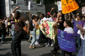 Supporters of two women beaten by New York City police officers march against police brutality