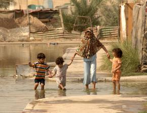 A displaced family living in a flooded section of Baghdad