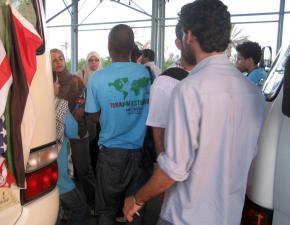 Members of the Viva Palestina delegation surround their bus to prevent Egyptian officials from taking them