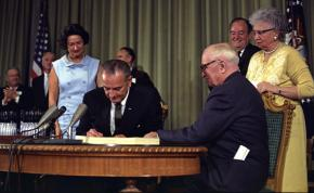 Lyndon B. Johnson signs Medicare into law in July 1965