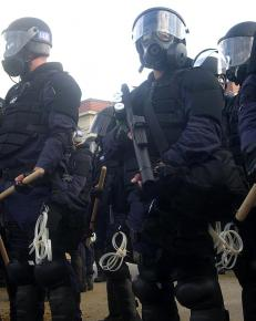 Police mobilize in full riot gear for a demonstration at the Republican National Convention