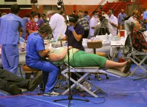 Volunteer dentists and health care workers provide care at the Great Western Forum in Los Angeles