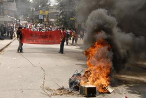 Protesters march through Tegucigalpa the day after Zelaya's return