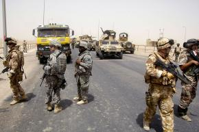 British troops, along with U.S. and Iraqi soldiers, maintain a checkpoint outside Basra