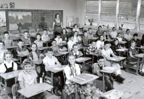 A teacher with her students in their classroom in 1958