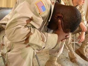 A U.S. soldier mourns the loss of a fellow soldier