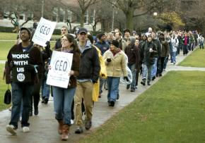 Members of the Graduate Employees Organization and supporters on the march at UIUC