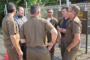 Tim Sylvester (left, facing camera), the newly elected president of Teamsters Local 804, with a group of UPS drivers