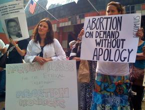 Protesters at a rally to defend abortion rights