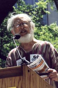 Dennis Brutus speaks at a global justice demonstration in 2004