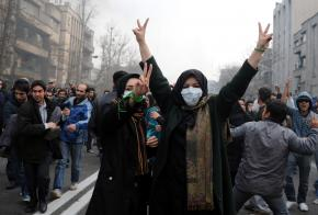 Iranian protesters flash a victory sign during demonstrations against President Mahmoud Ahmadinejad