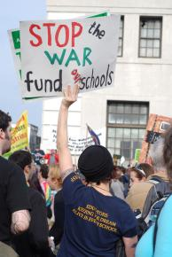 A UESF member rallies for funding for schools, not war
